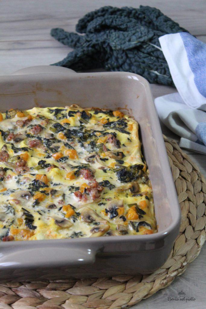 Lasagne con cavolo nero, zucca, funghi e salsiccia