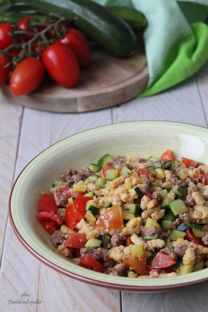 Passatelli con zucchine, salsiccia e pomodorini
